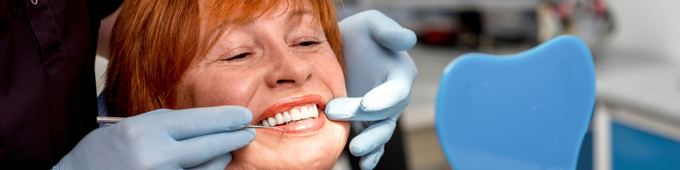 Inspecting woman's teeth