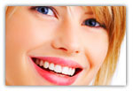 Woman smiling after receiving dental implants in Littleton, CO