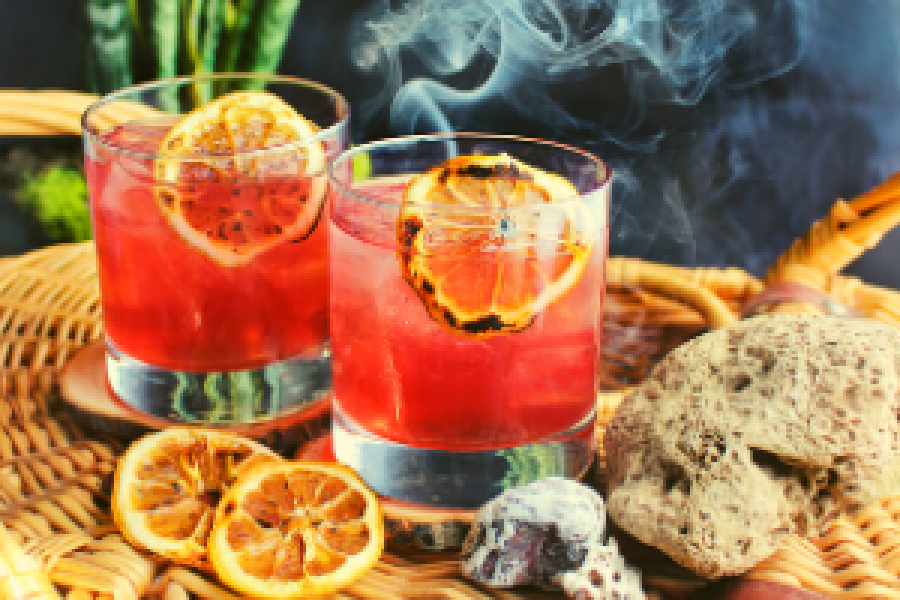Two cocktails with orange slices as garnish