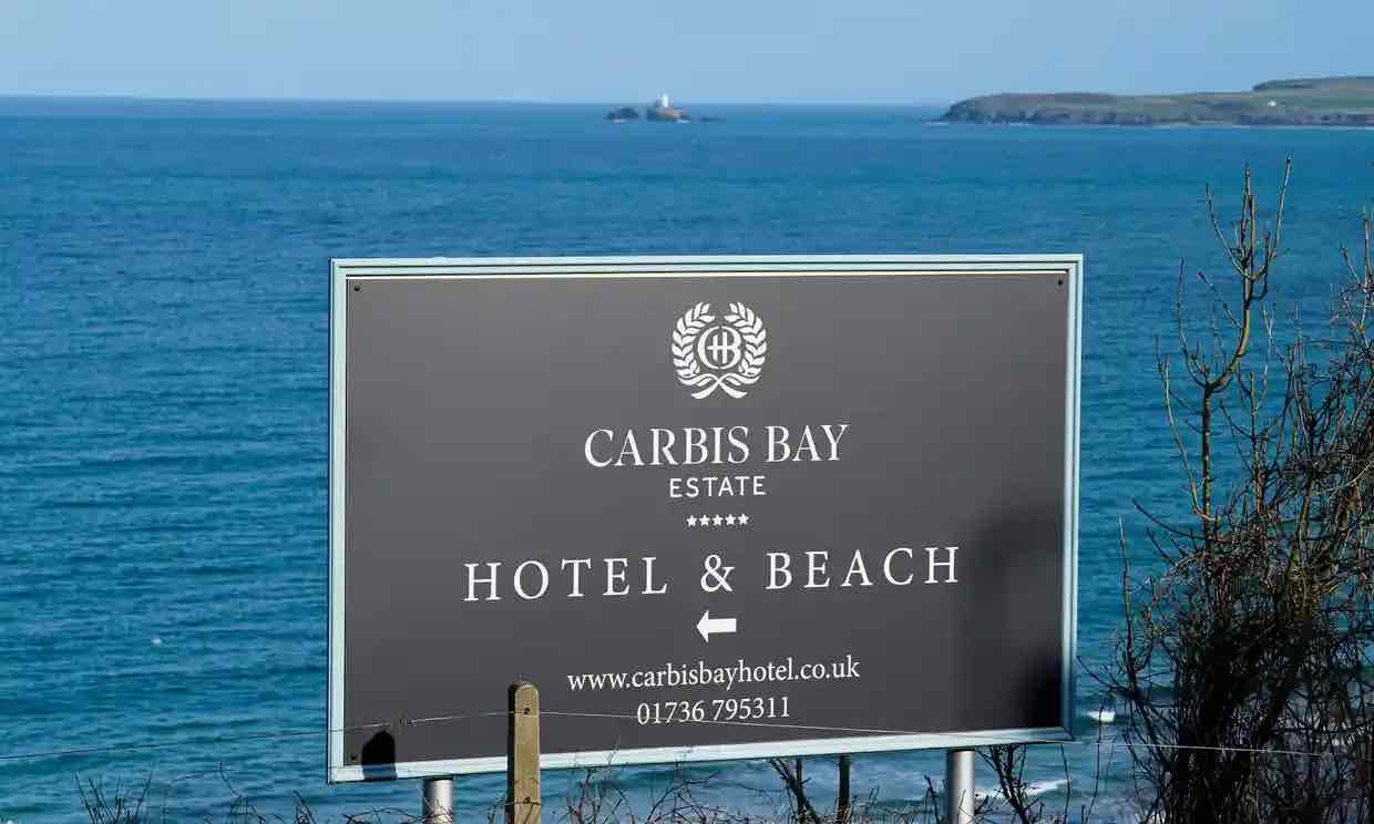 a sign pointing towards Carbis Bay Estate. Photo by Hugh Hastings / Getty Images.