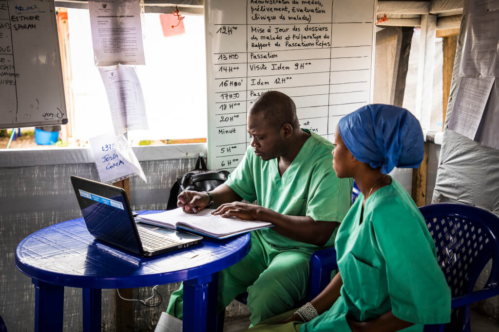 two doctors in a morning briefing in the fight against Ebola