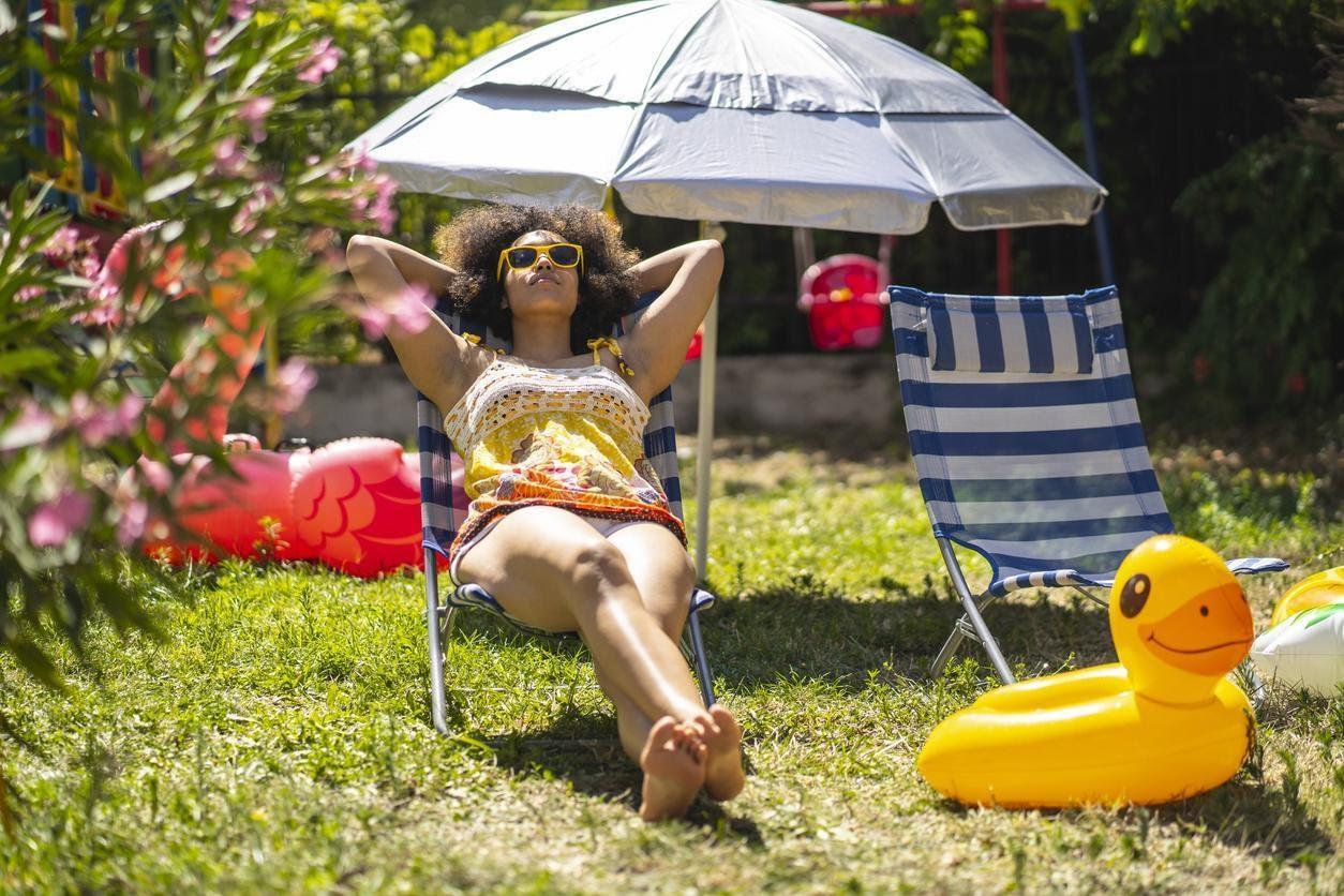 woman-sunbathing-backyard