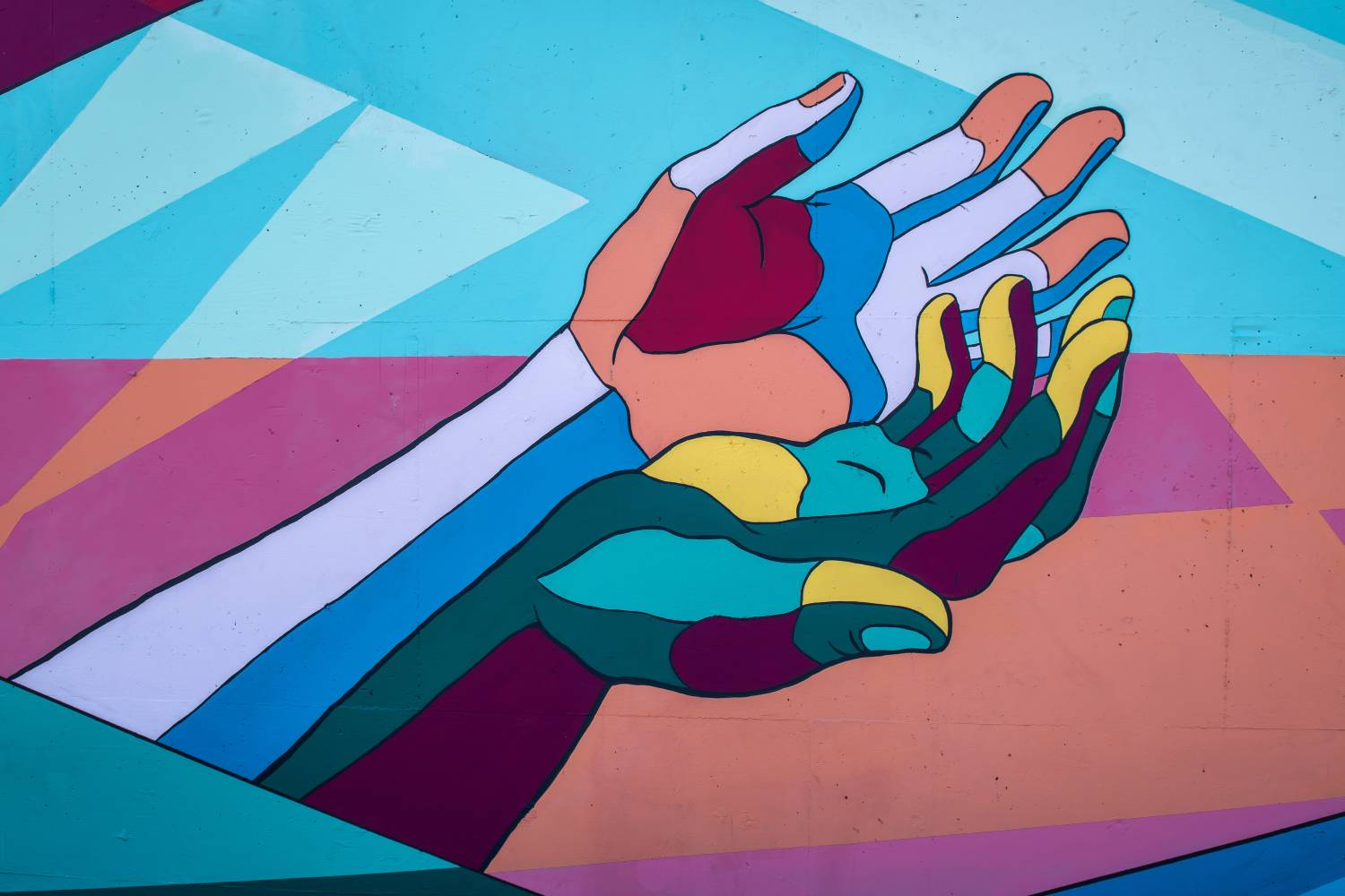 colorful graffiti with two hands