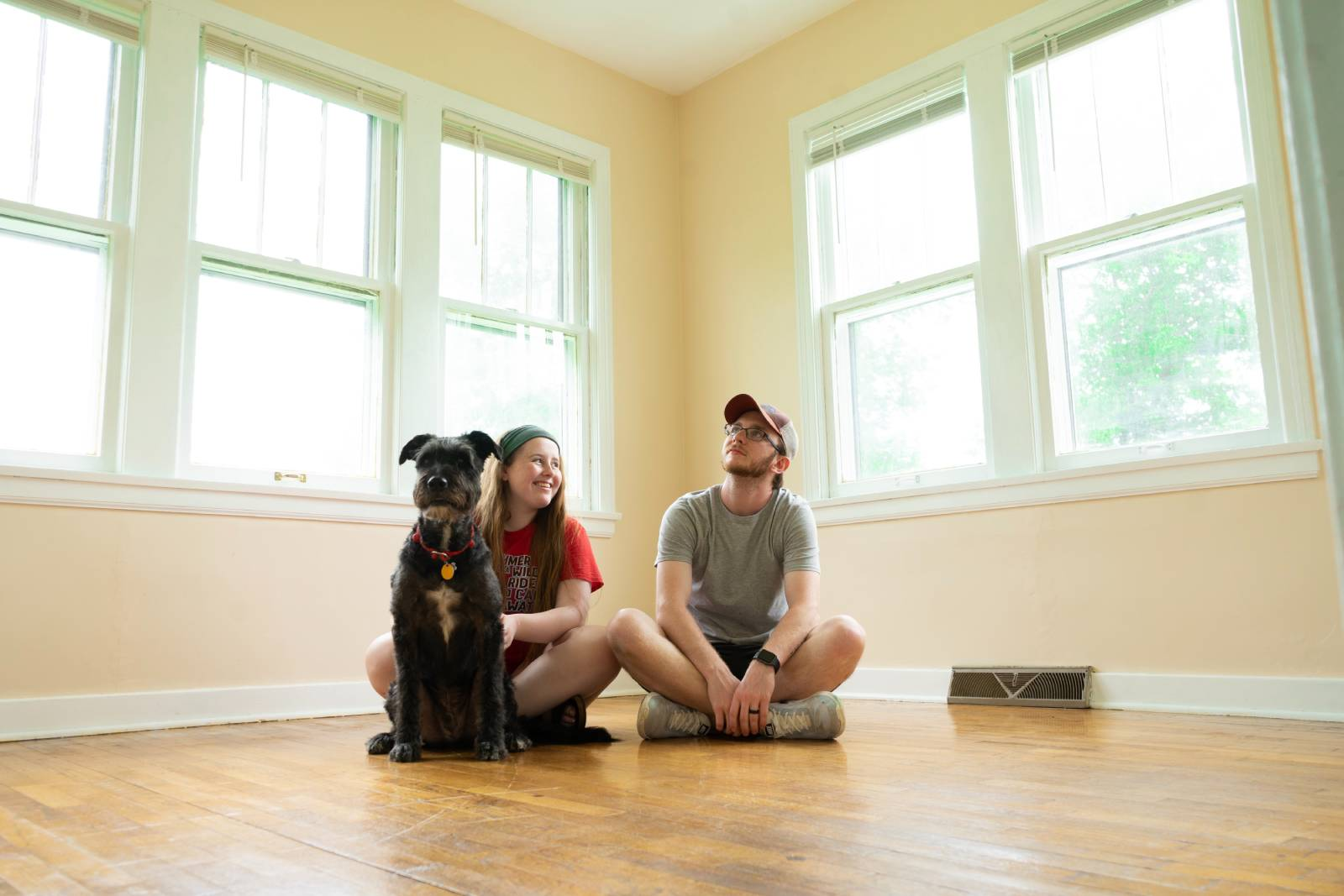 A couple move in with their dog in a new apartment