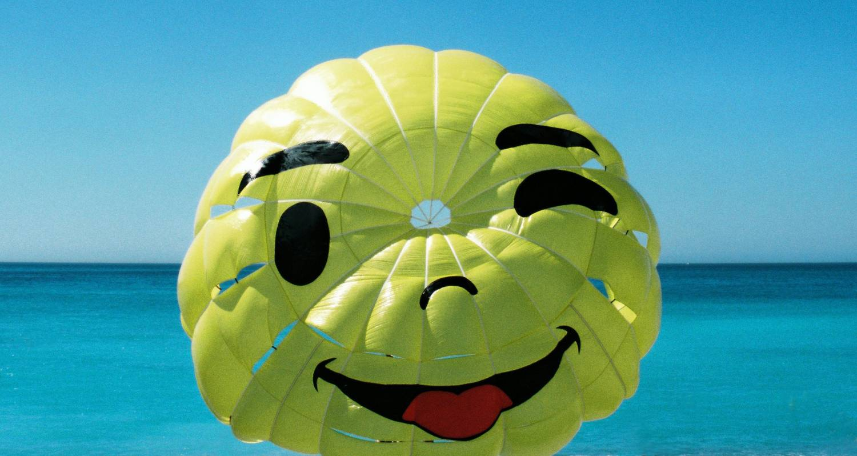 friendly emoji graphic on parachute