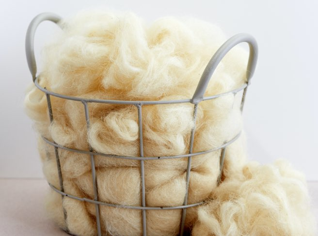 light yellow textile fibers in a basket
