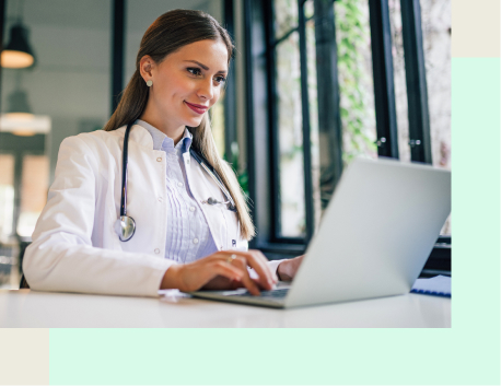 A doctor looking at a laptop