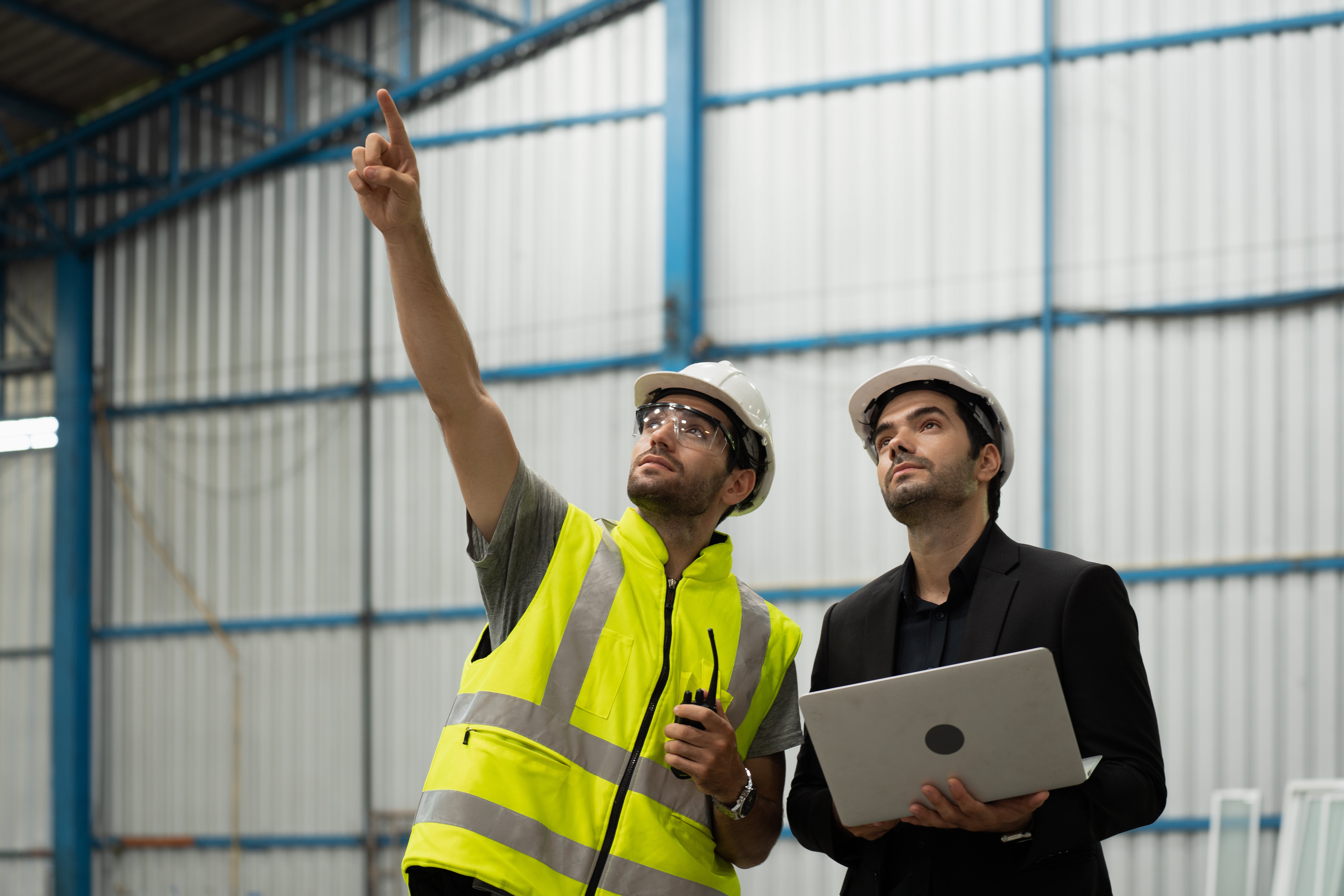 Two people looking up and pointing