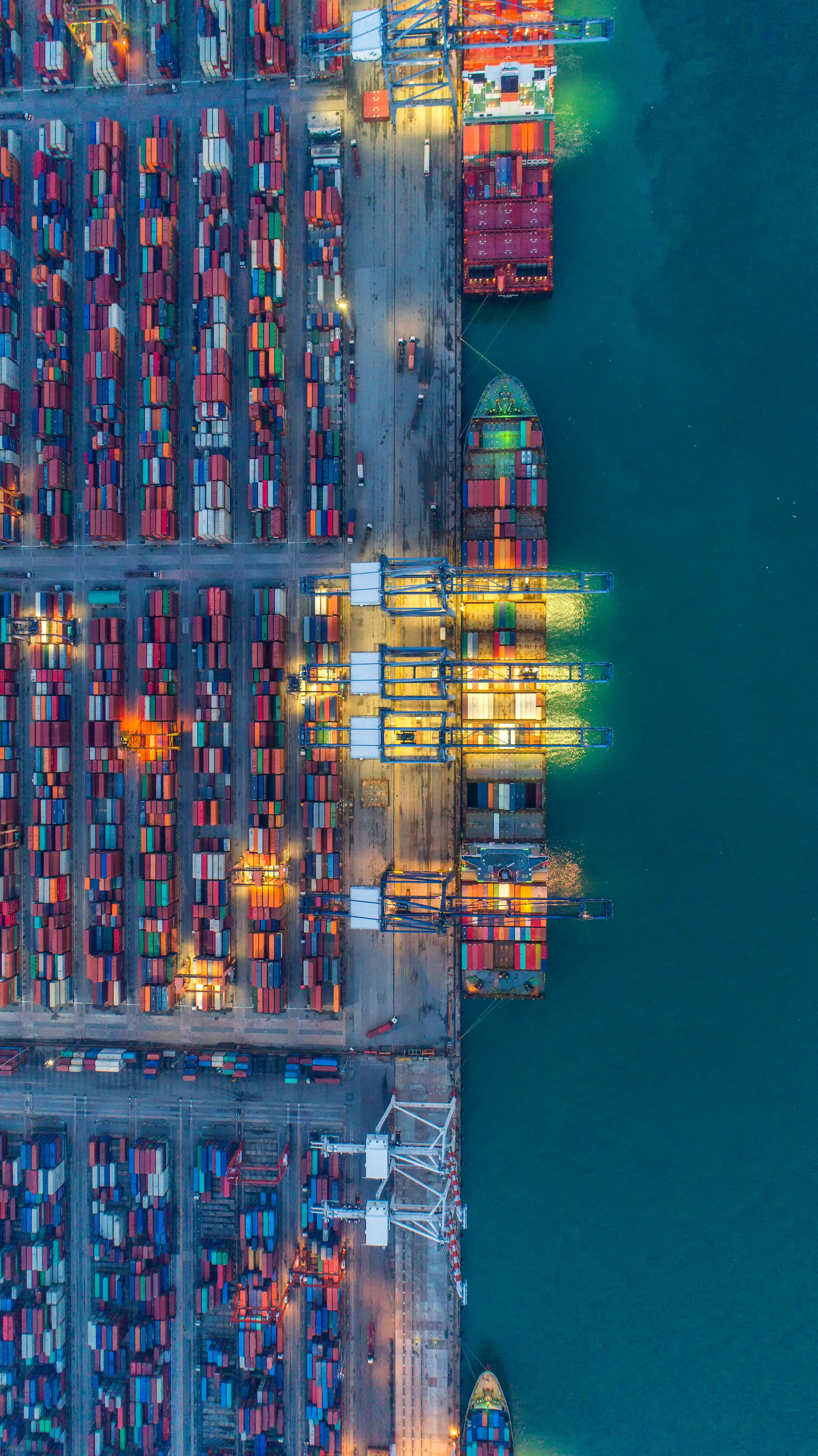 Overhead view of shipping container loading bay at night
