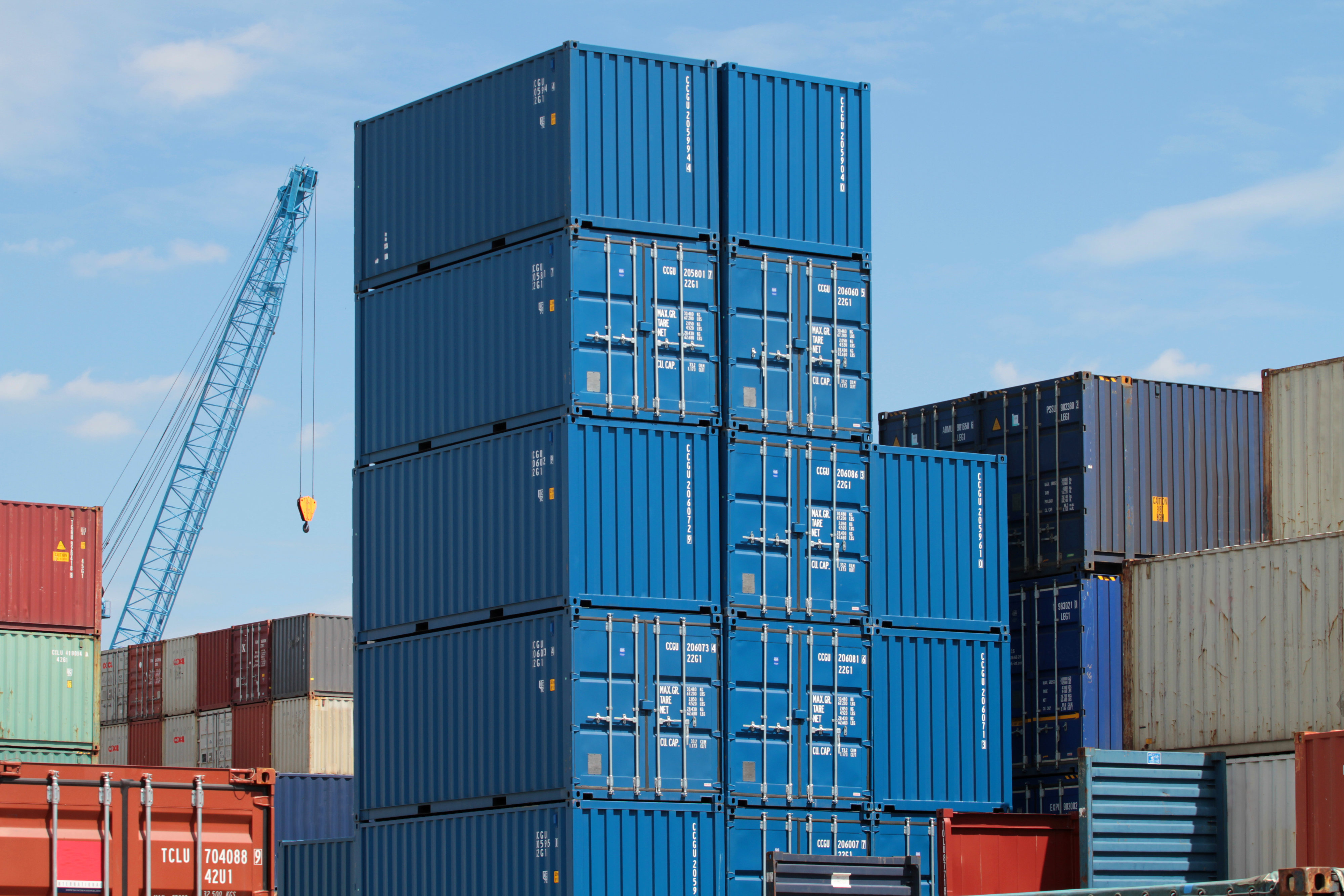 large stack of blue shipping containers