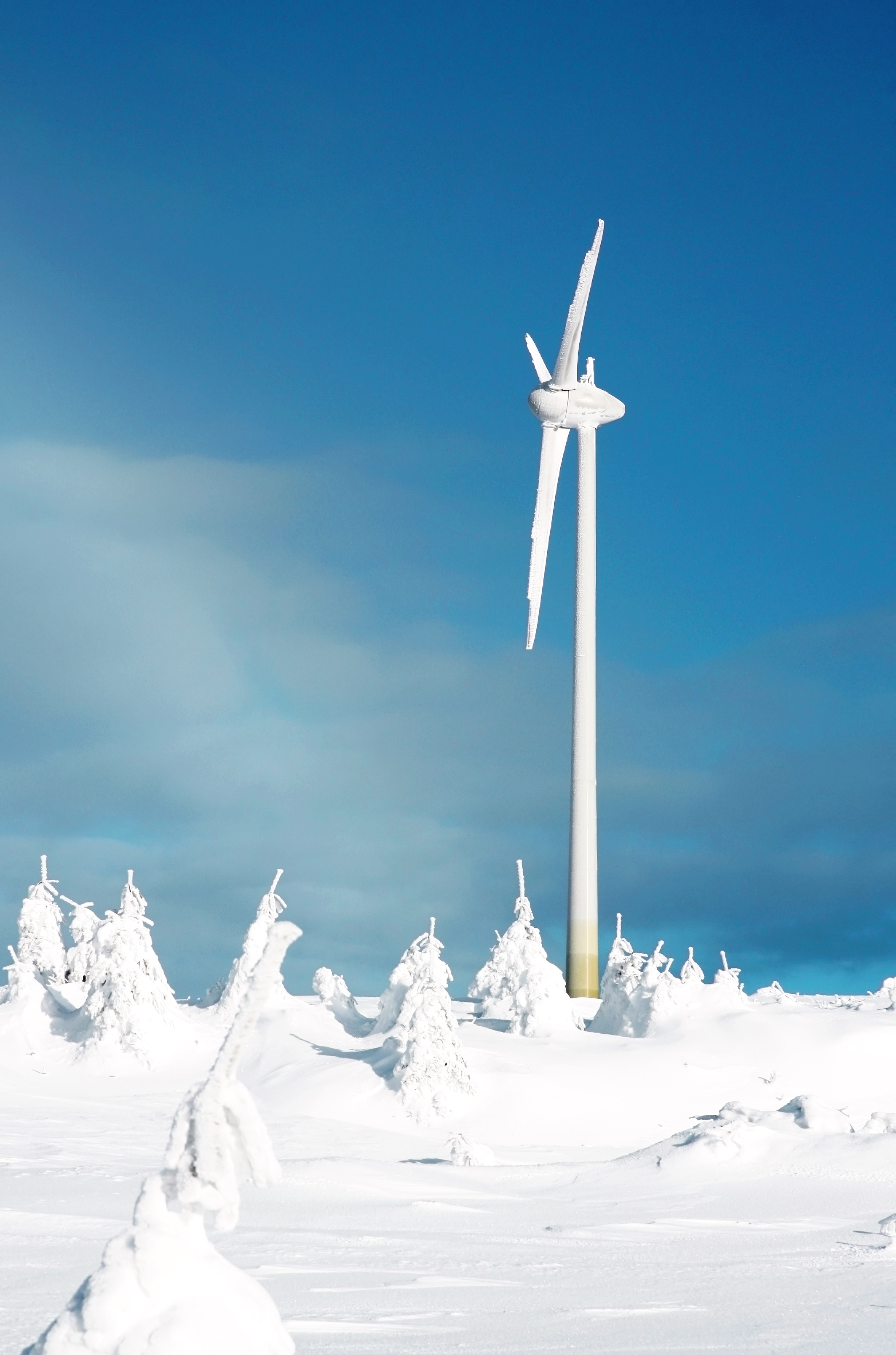 A lone turbine in a snow covered landscape.