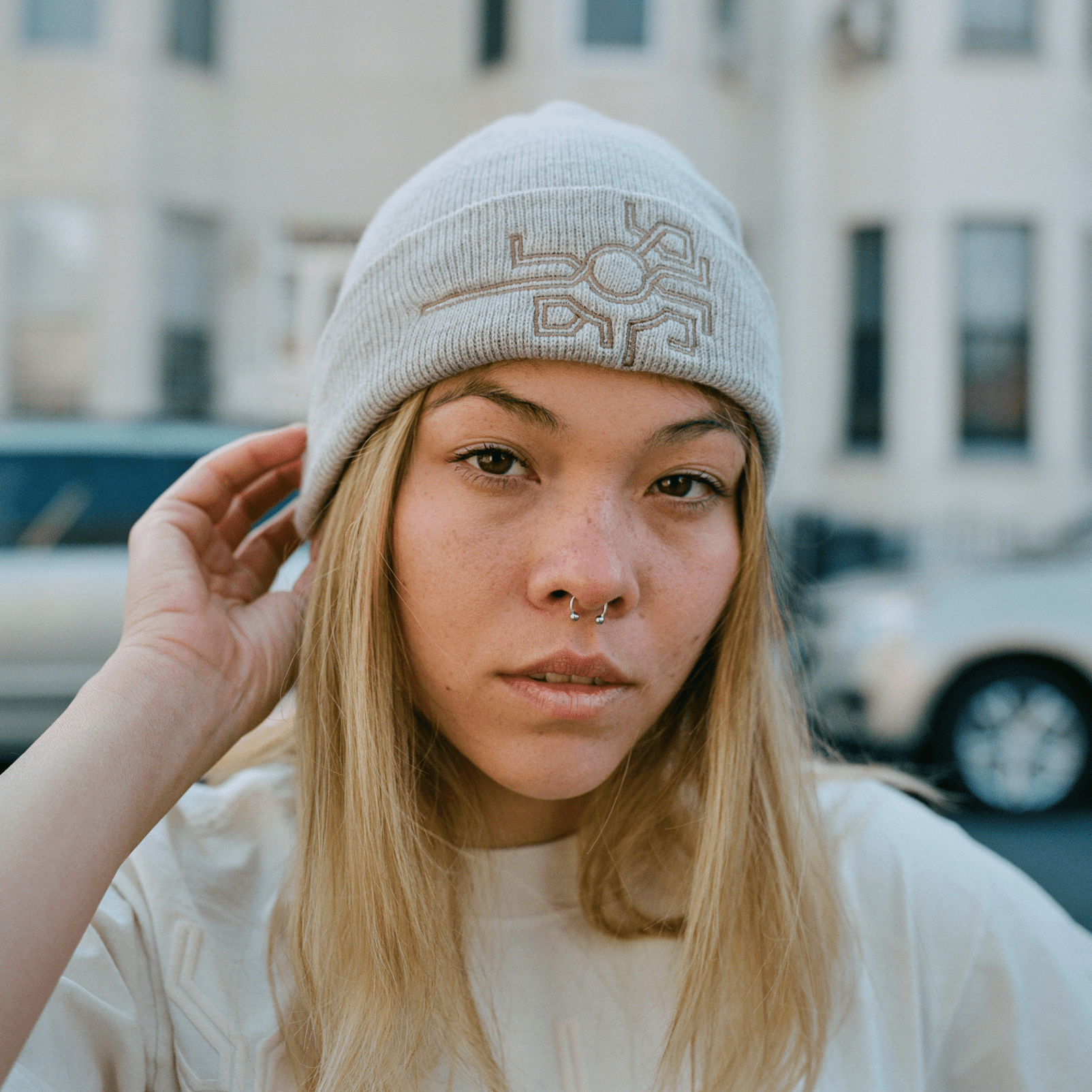 Beige beanie with embroidered khachkar detail in tribute to Armenian cemetery in Julfa
