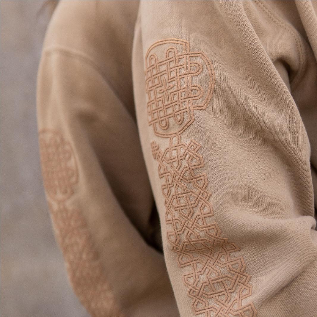 Khachkar detail on two sandstone sweaters