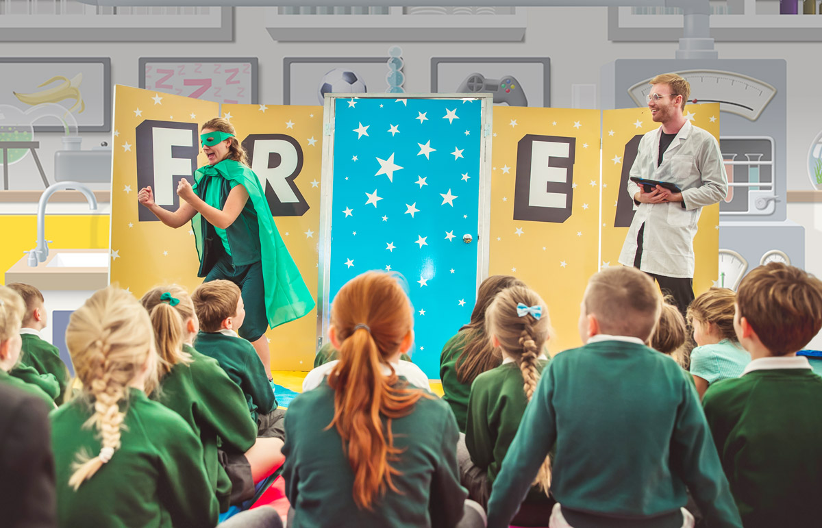 FRED and the Professor performing the experience to school children