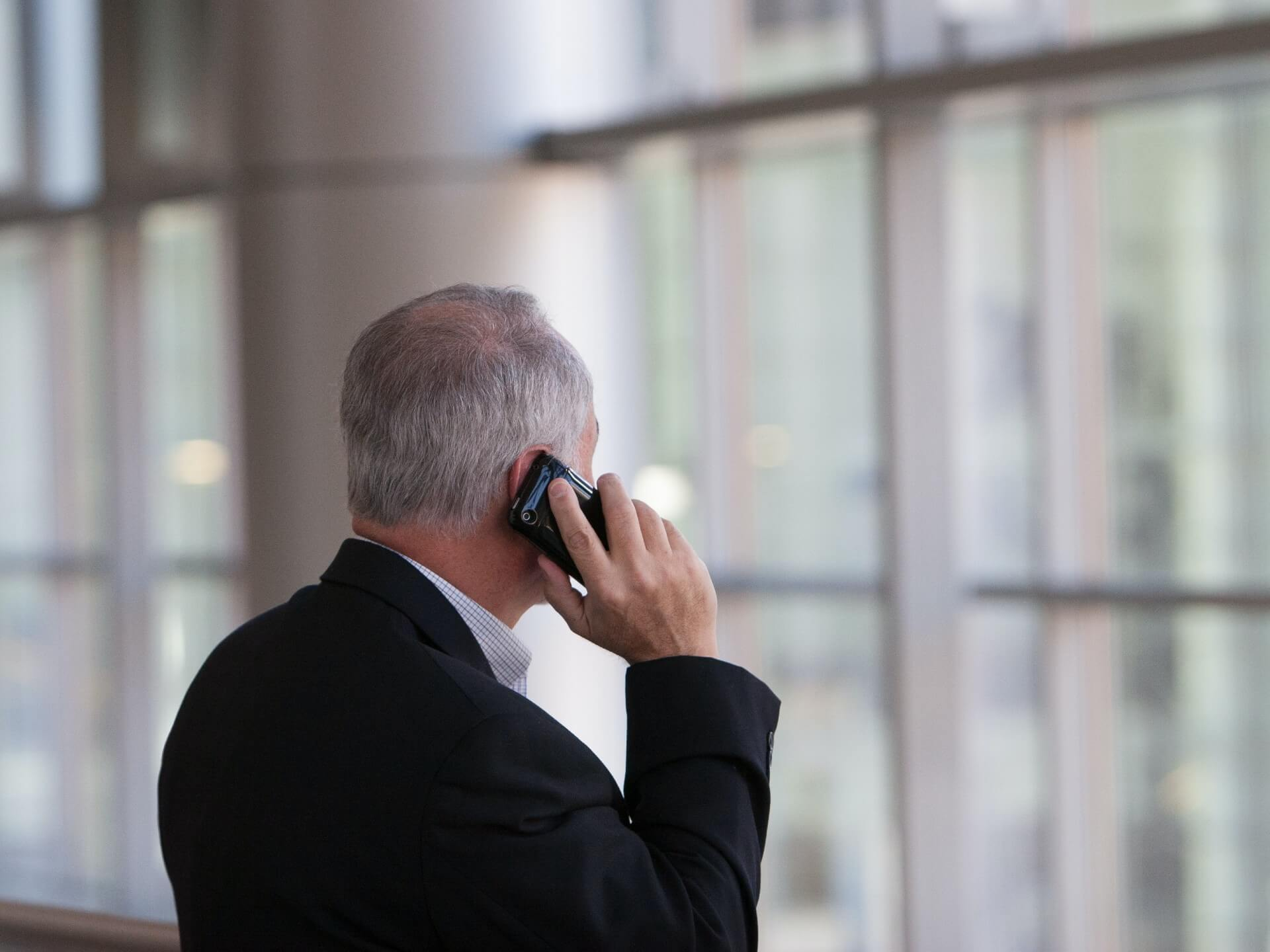 older man making a phone call to ConciMed to book his Podiatry consultation
