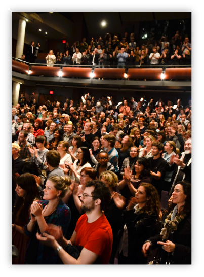 Audience applauding at a large conference