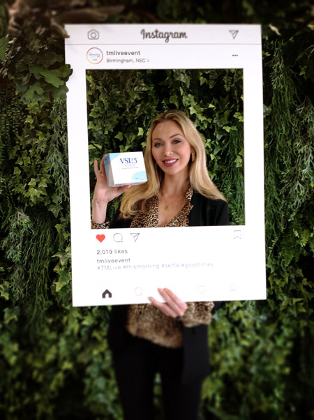 A woman posing with VSL3 in an Instagram frame.