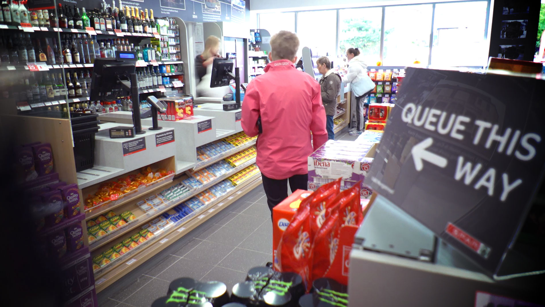 Customers queueing at a SPAR store