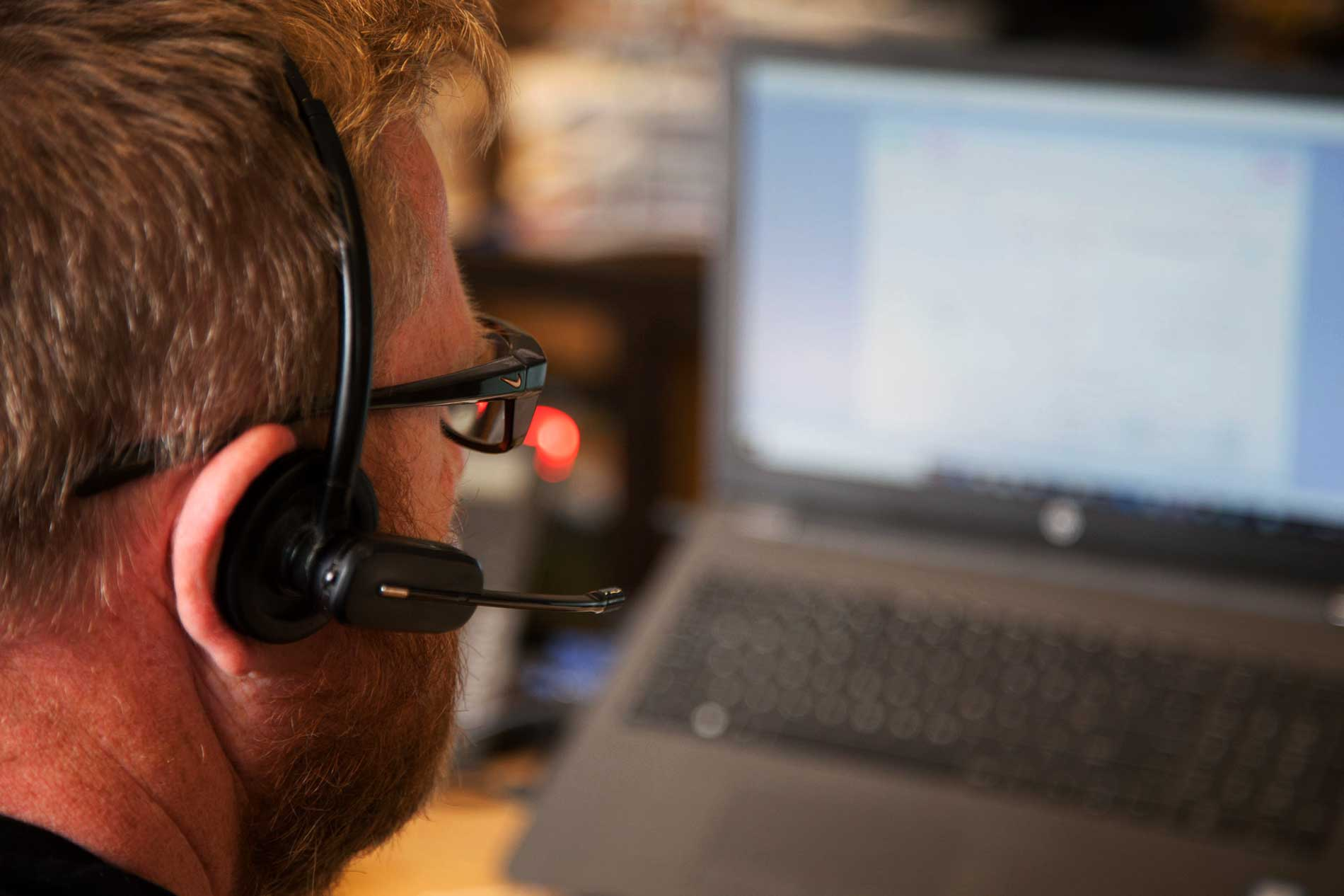 Member of staff using a telephone headset
