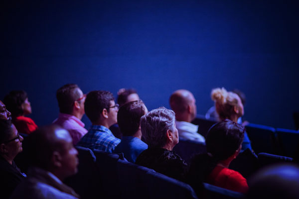 A audience in a cinema watching a film