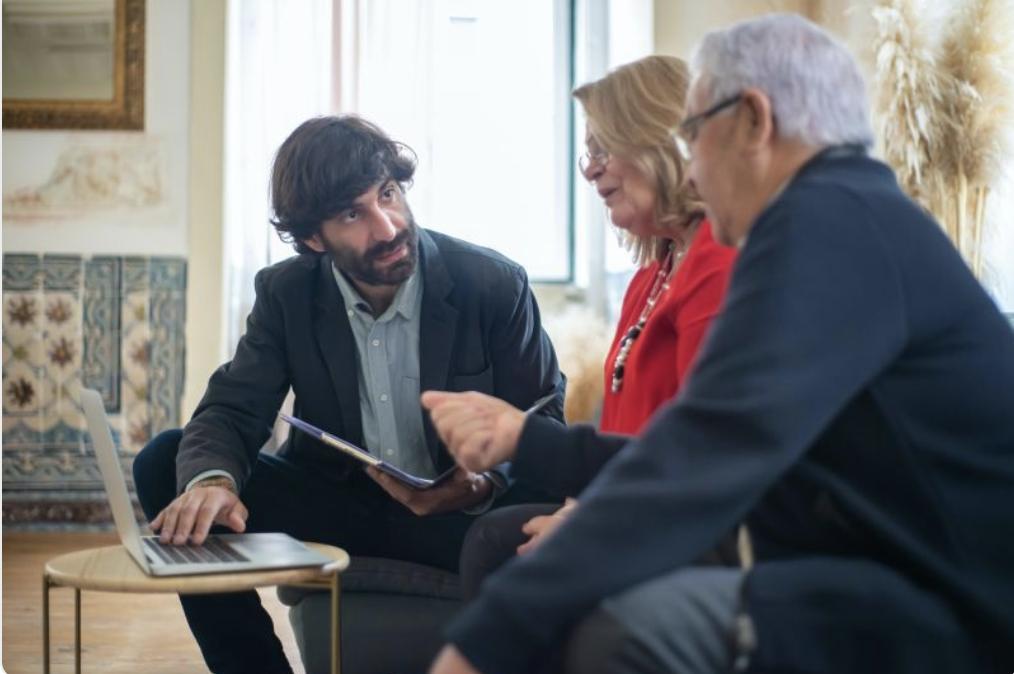 Advisor meeting with senior clients