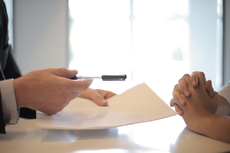 Insurance paper, advisors hands, pen