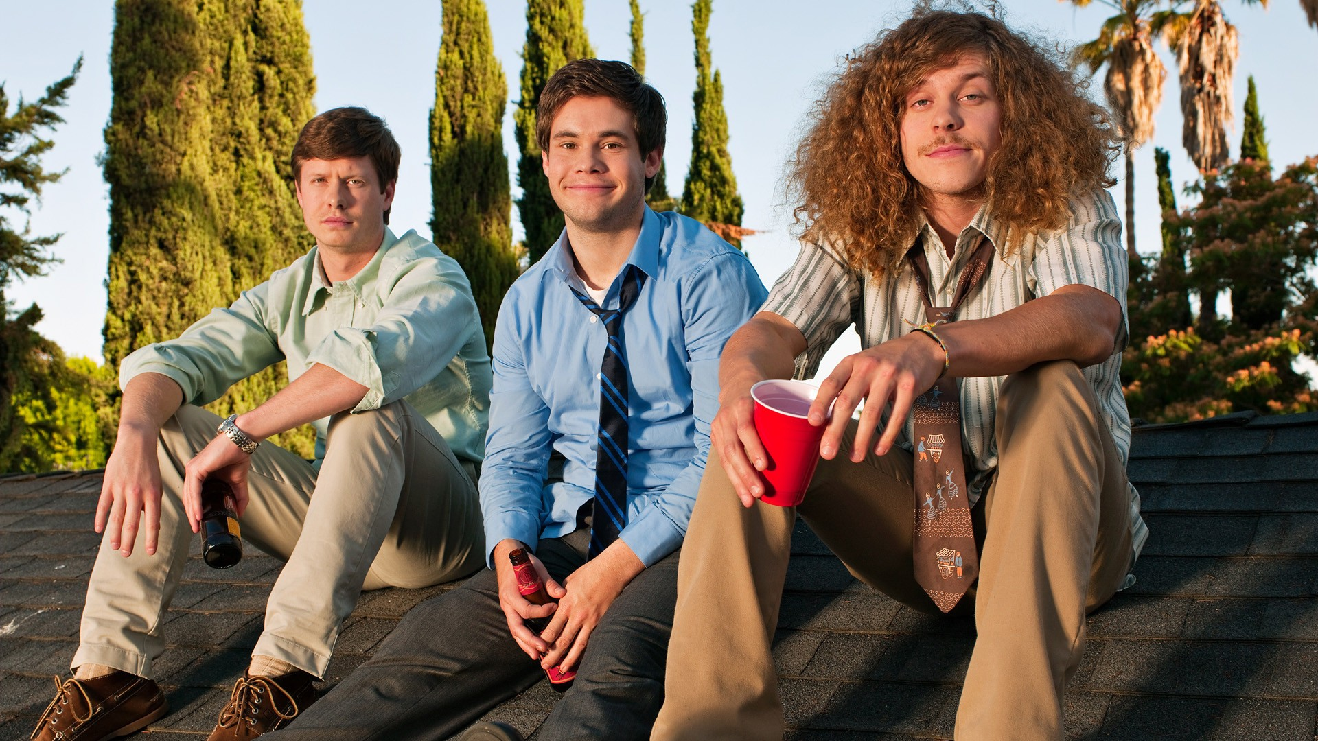 Workaholics sat on a roof drinking