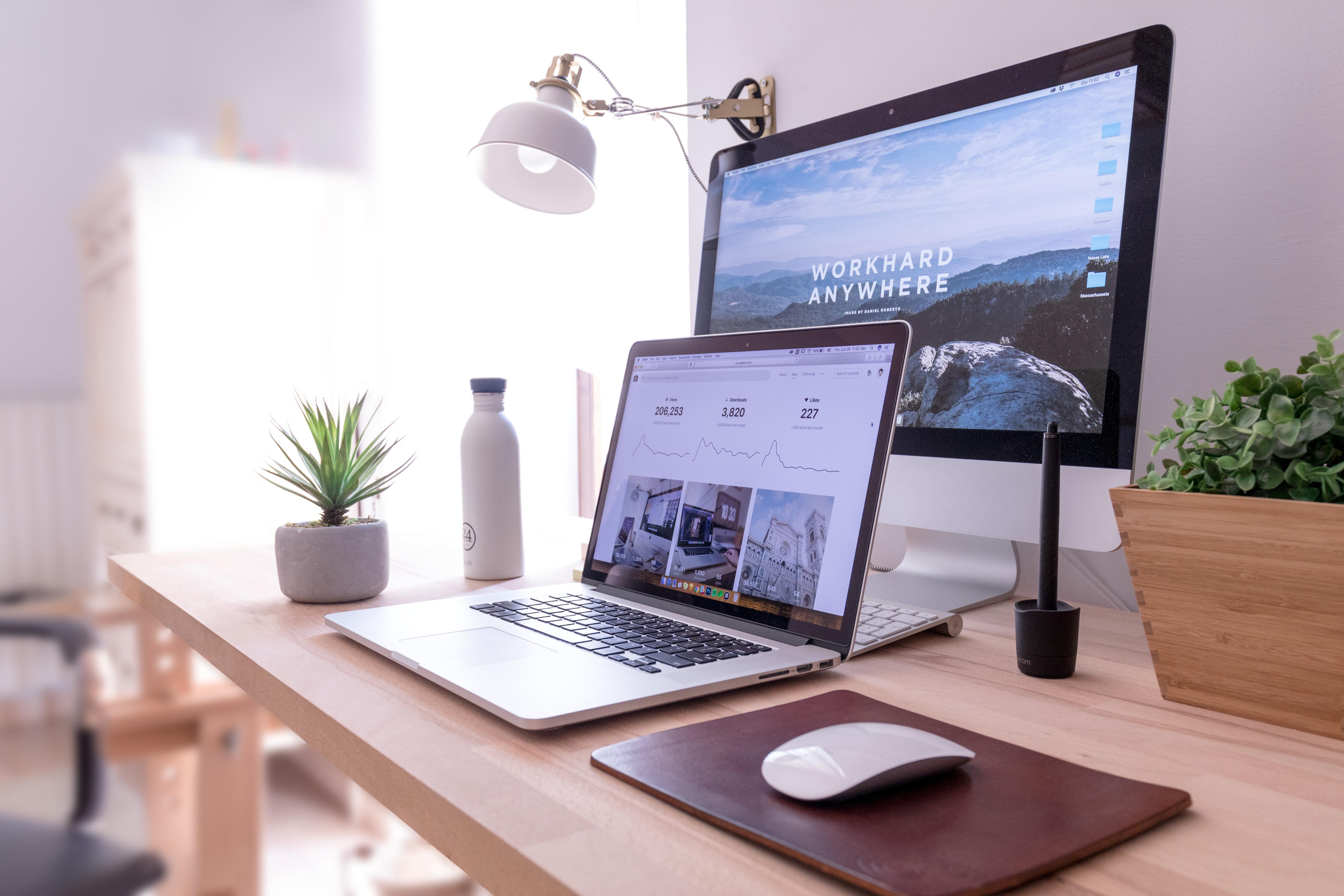 desktop with desktop and laptop computers
