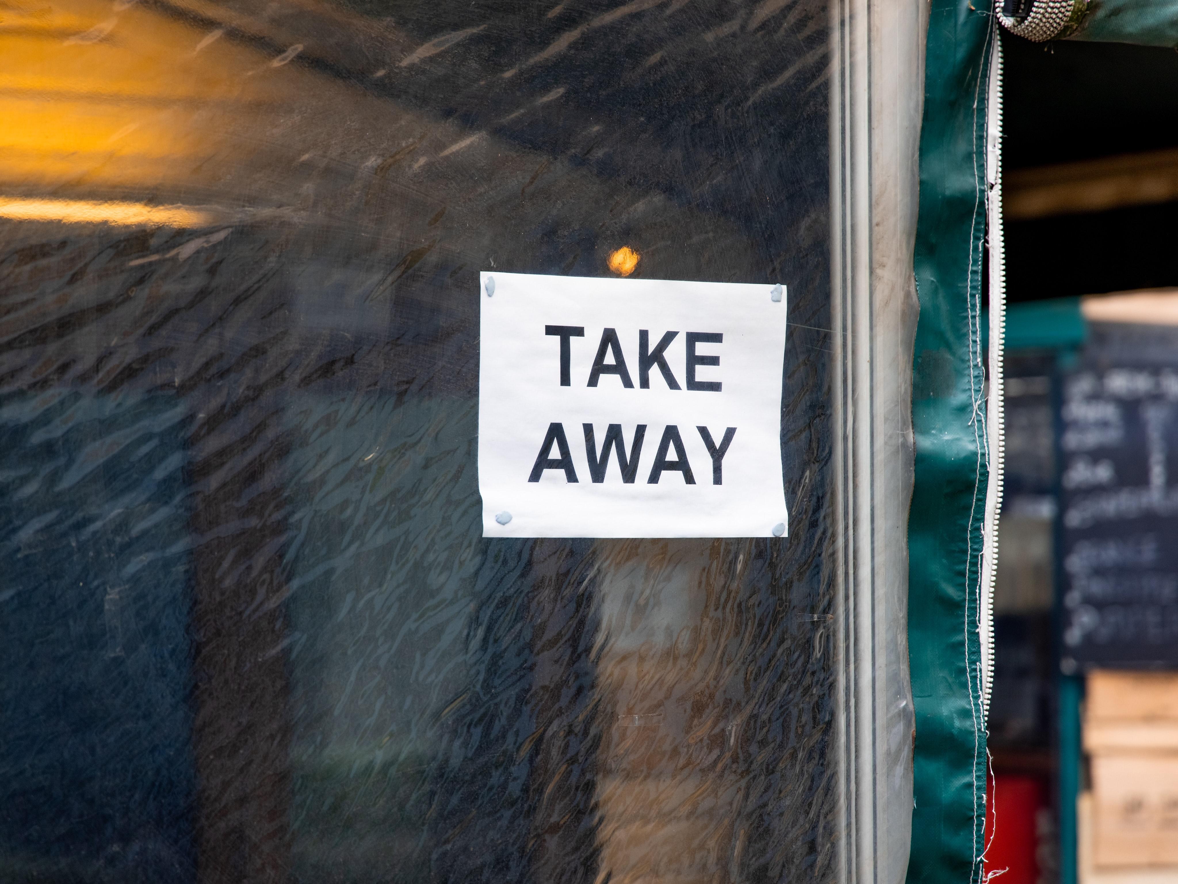Take Away sign on glass window
