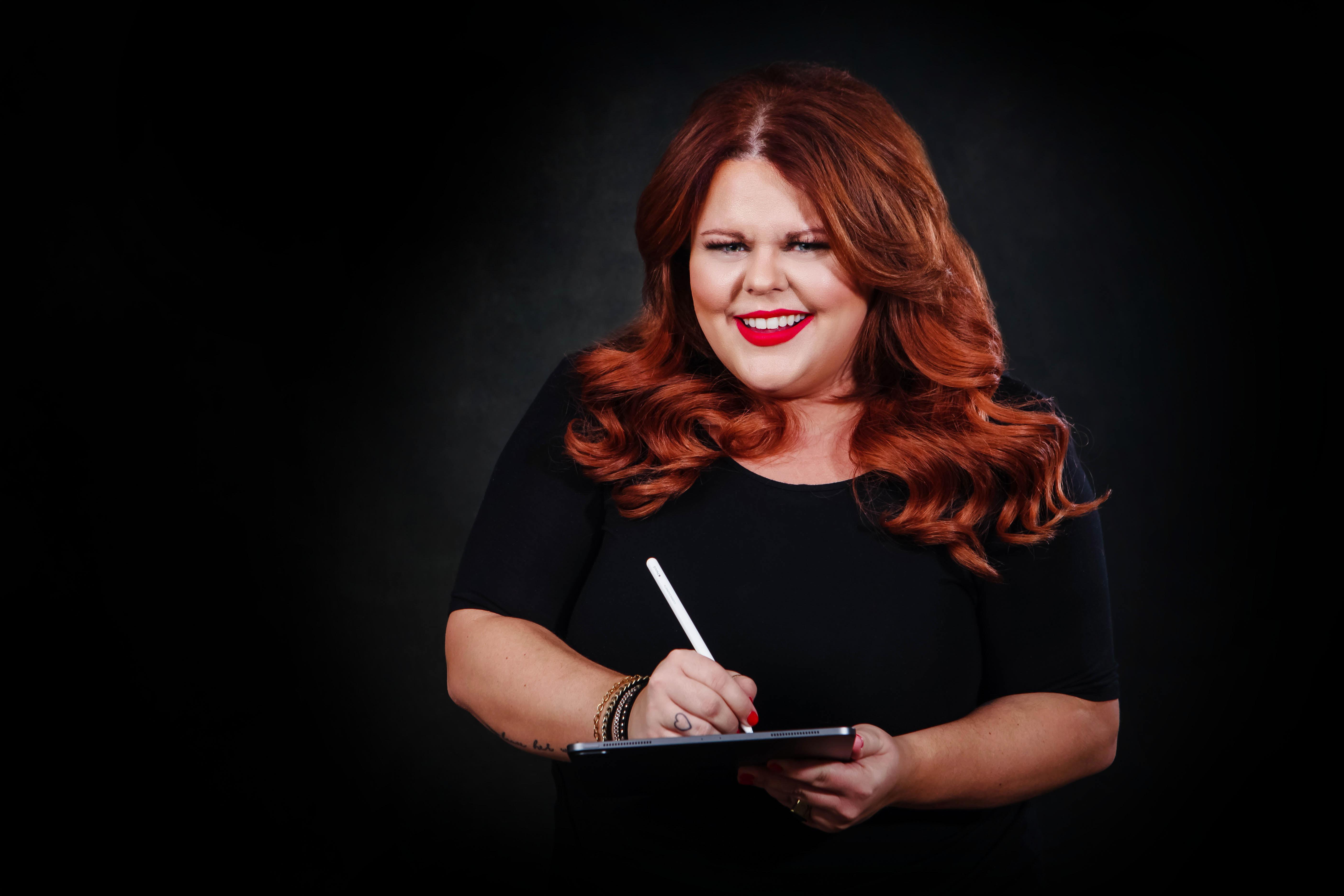 Karine Parthenais writing on IPad with stylus