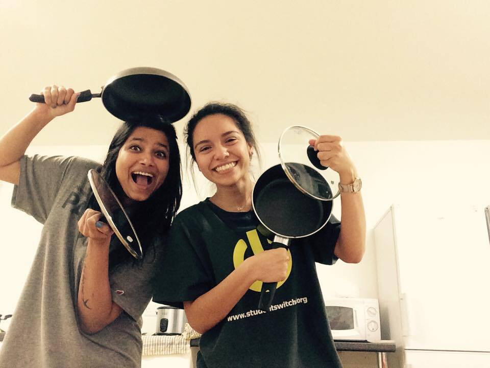 Students hold pots and pans
