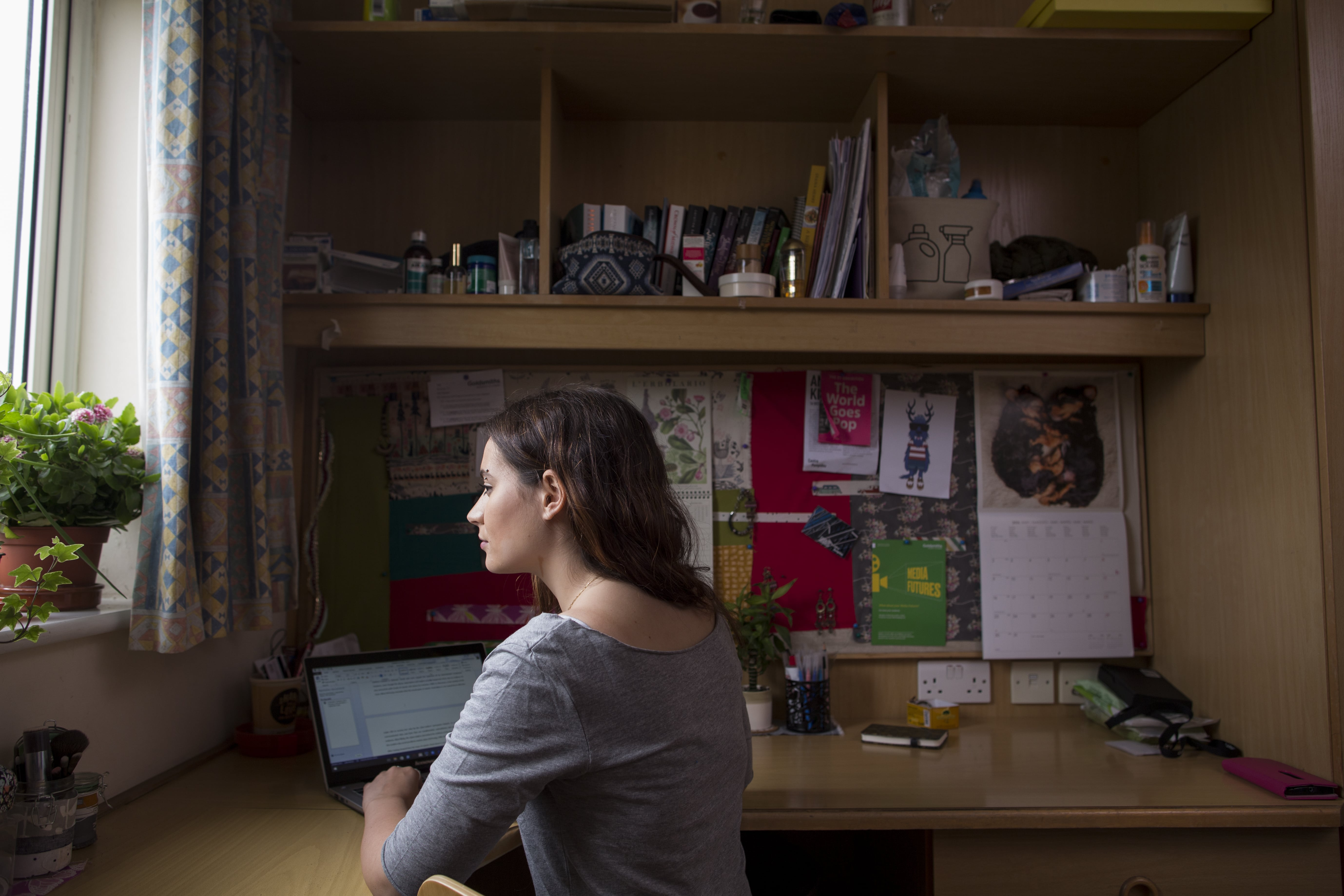 Student works at their desk