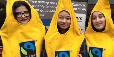 three students wearing fairtrade banana costumes