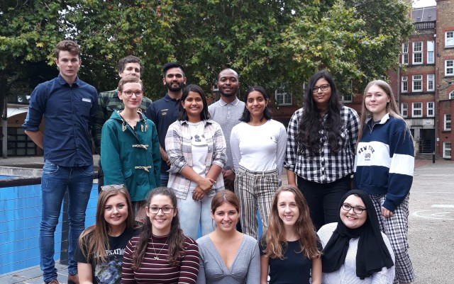 Students For Trees council 2019-21 stands outside in a yard in front of a tree