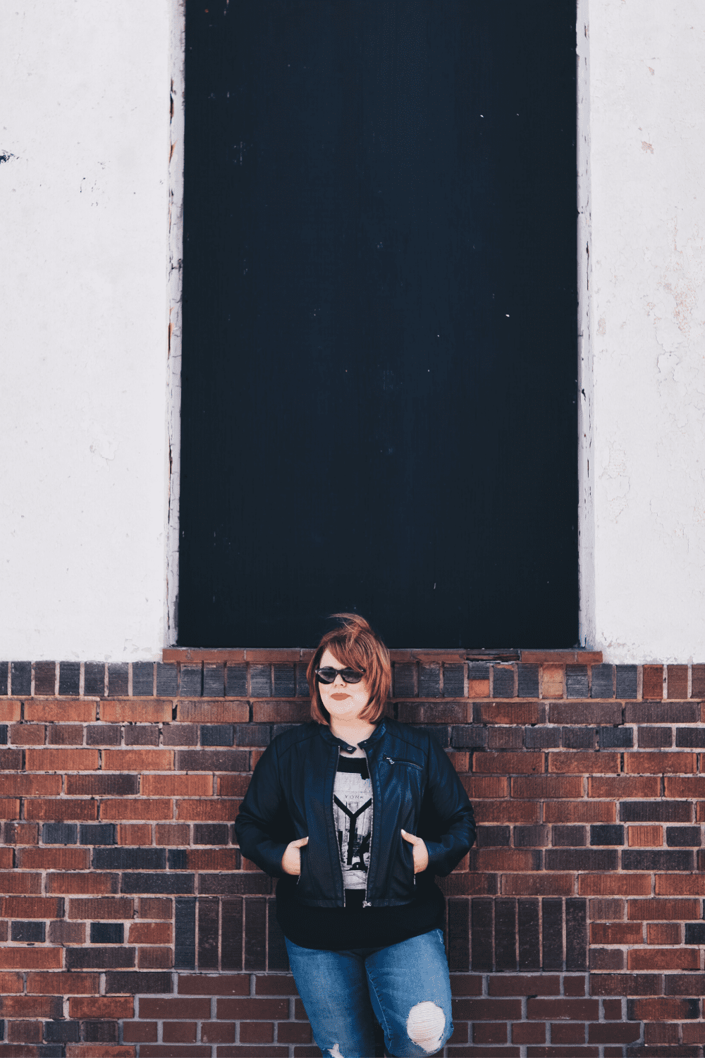 Karine Parthenais standing in front of a brick wall
