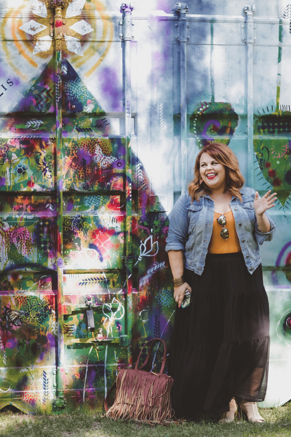 Karine Parthenais in front of a graffiti wall