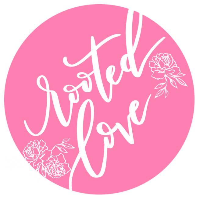 Rooted Love Logo - white script font within a pink circle