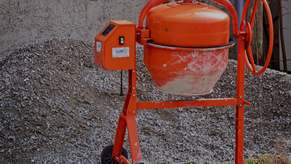 red cement mixer with stone background