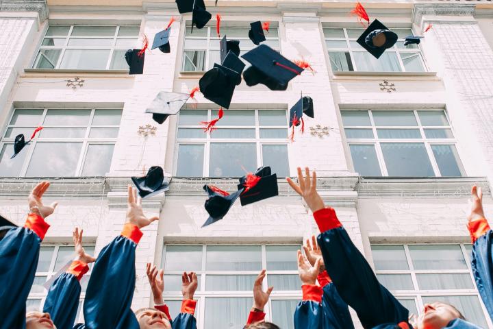 Graduates throwing their hats