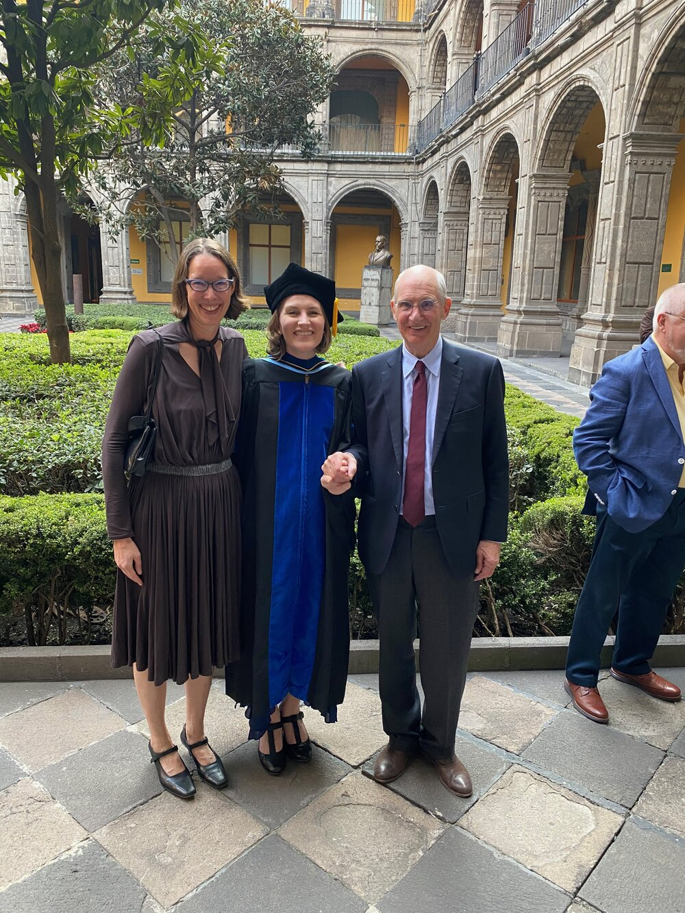 IDSVA's Amy Curtis and George Smith with the newly minted Dr. Christina Barber in the courtyard of el Antiguo Colegio de San Ildefonso. Photo courtesy of Christina Barber