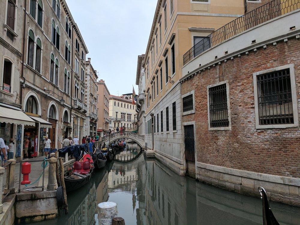 People walking along one of Venice's many canals Photo Credit: Jonathan Morgan