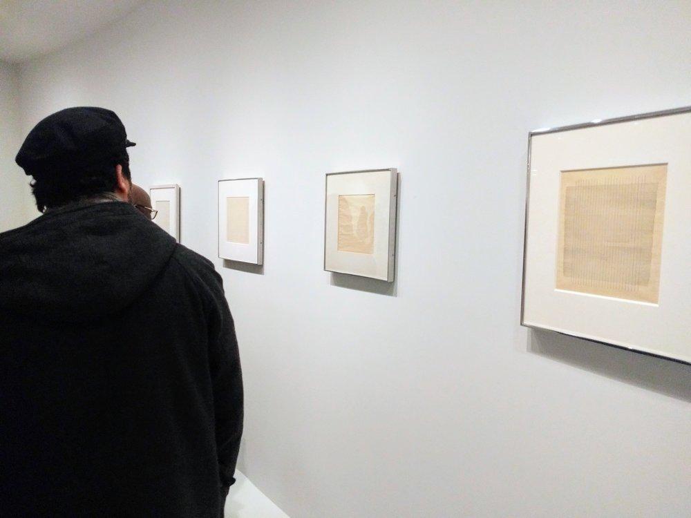 DSVA student Milos Zahradka Maiorana examining some of Martin's drawings, Guggenheim, 2017. Photo by Jonathan Morgan