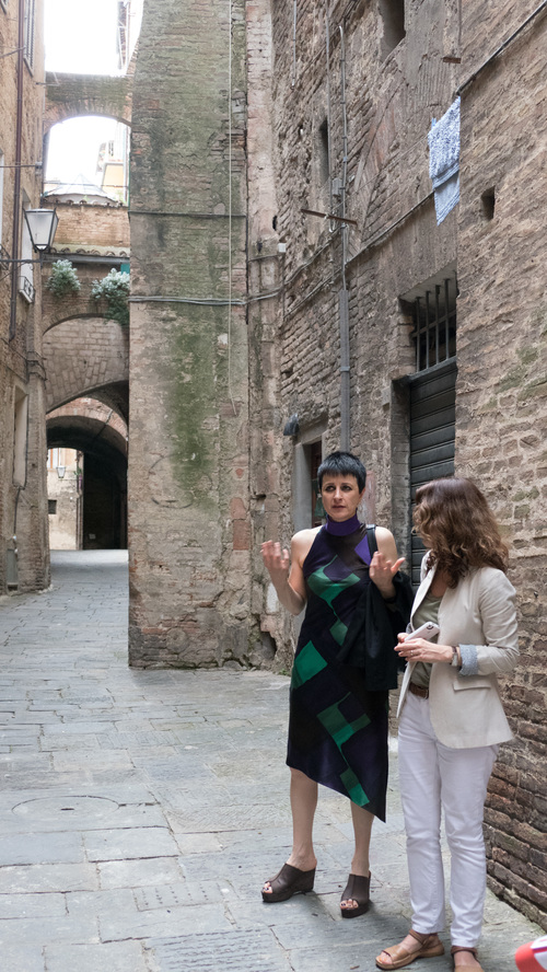 Franca Marini giving the group a tour through the narrow residential streets of Siena.