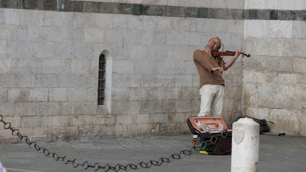 Unknown Street Musician on streets of Siena.