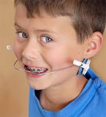 Boy with braces and headgear