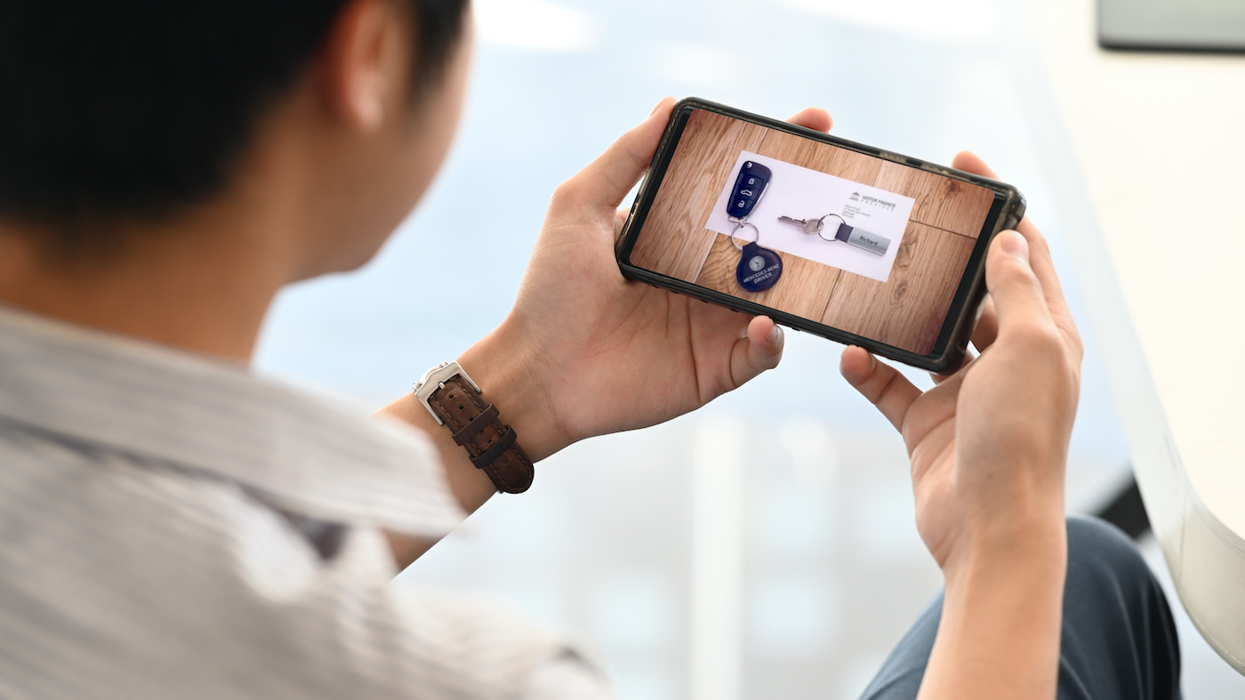 Image of a video displaying on a mobile device in someone's hand