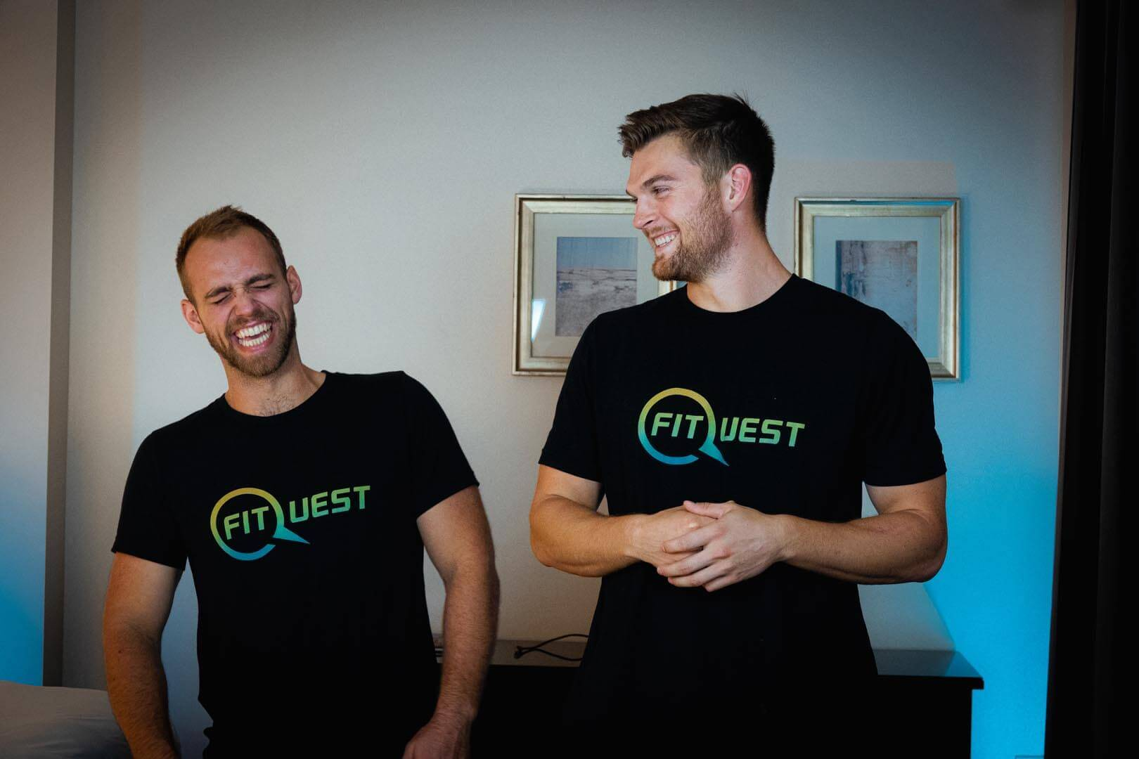 Braden Mosley and Ben Hermann laughing in a hotel room
