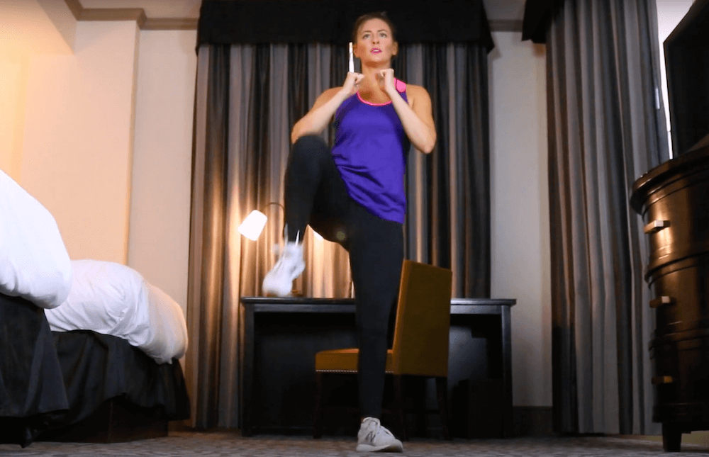 FitQuest Model doing a sumo squat in a hotel room - FitQuest