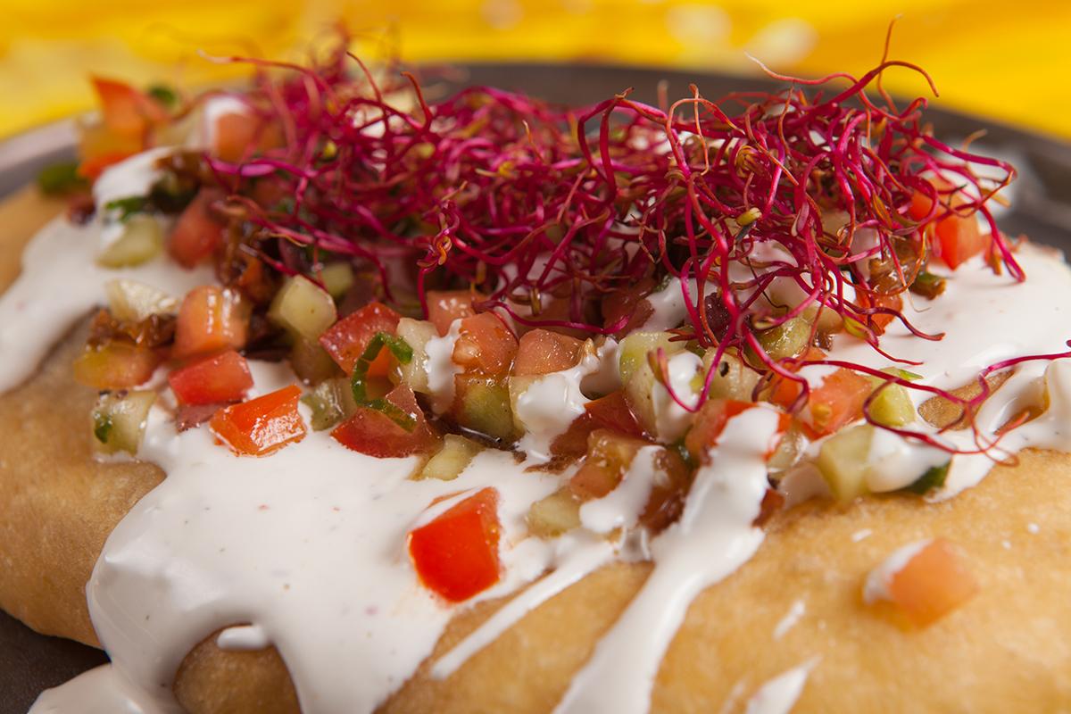 Refreshing Mediterranean yogurt dressing on fluffy dough