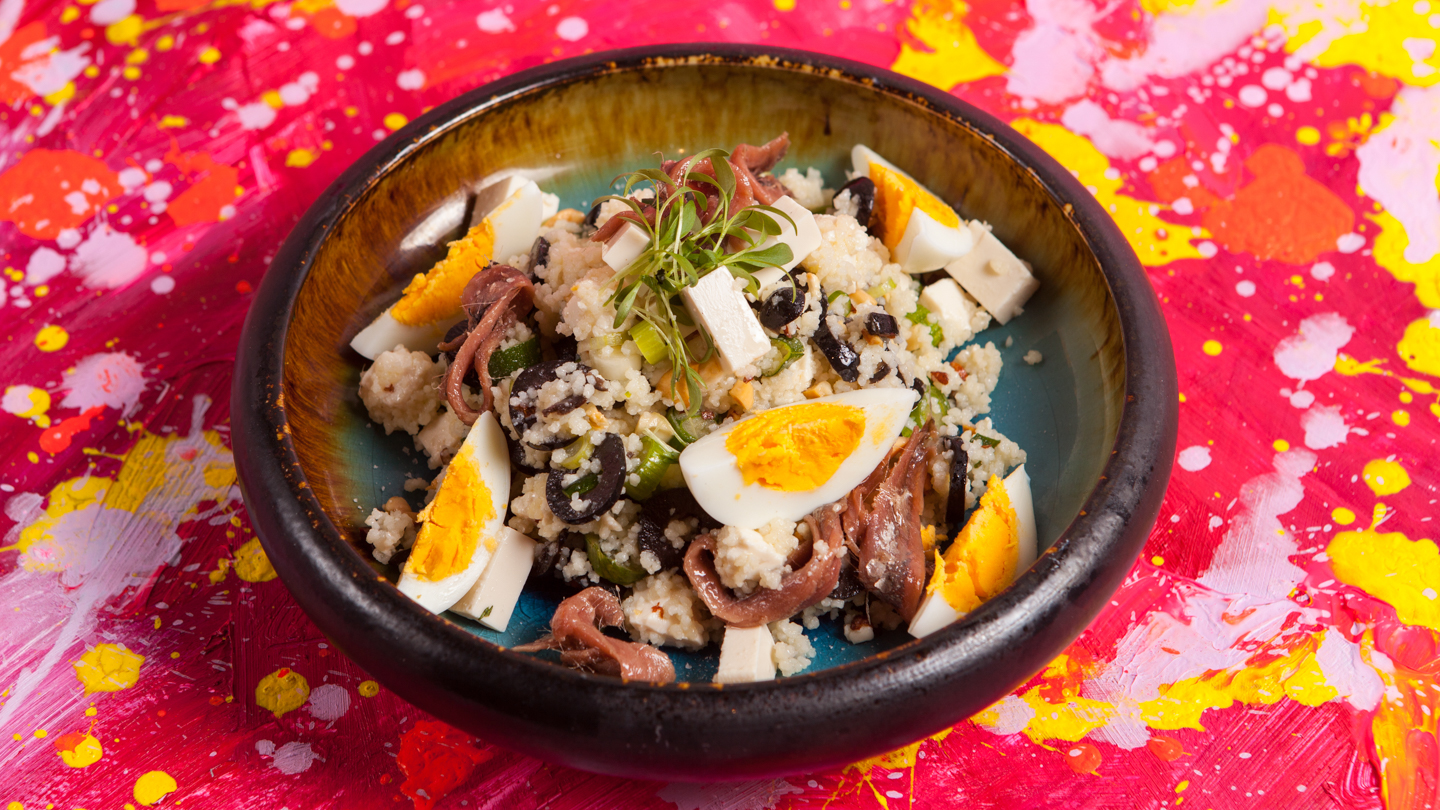 Oriental salad with refreshing taste made from anchovies, leek and couscous
